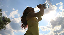 Sports Lady Drinking Bottled Water