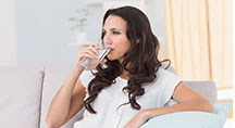 Lady relaxing drinking water